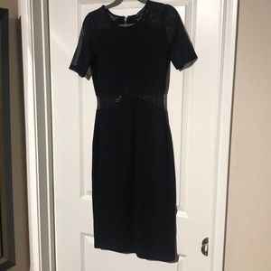 Black dress with sheer sleeves and waist cutouts
